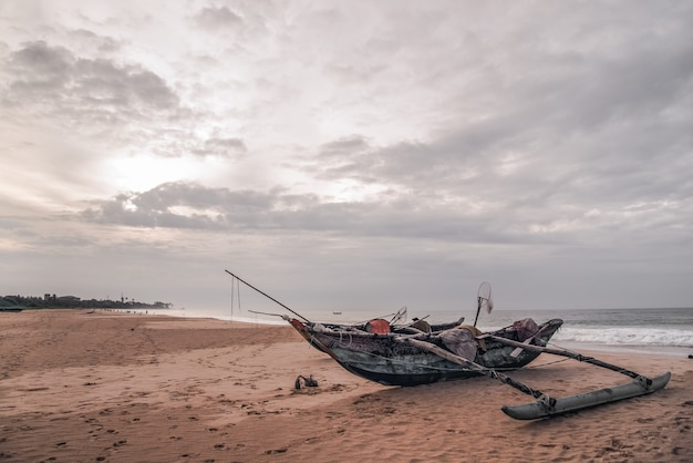 Old fishing boats on empty beach in sri lanka.
