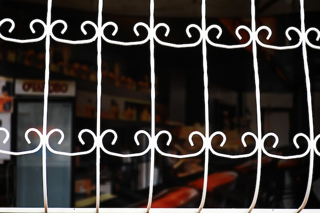 Old forged gate. fragment of the pattern of metal. rusty metal. metal grill from rusty plates