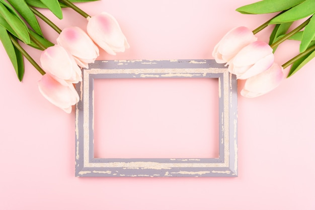 Old frame with tulip flowers