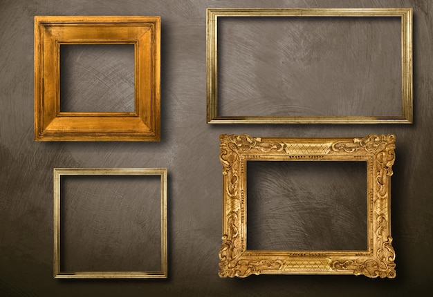 Old frames hanging on wall