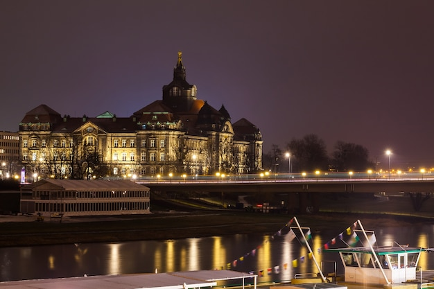 Old german city of dresden on river elbe at night.