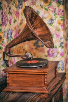 Old gramophone on the background of bright walls