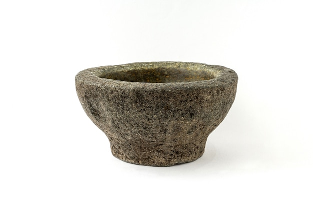 Old granite pestle and mortar isolated on white background.