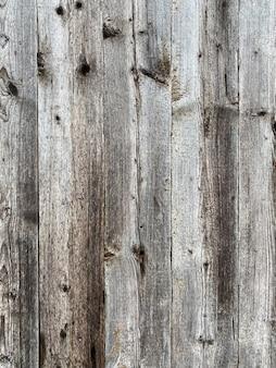 Старый серо-коричневый деревянный фон из темного натурального дерева в стиле гранж вид сверху natur ...