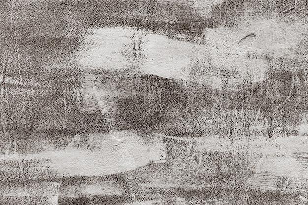 古い灰色の塗られた壁の背景