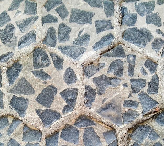古い灰色の敷石が美しい形で配置されています。バックグラウンド