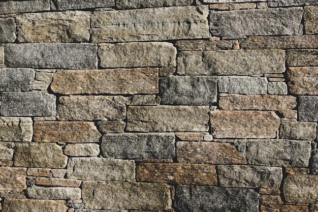 Old gray urban brick wall background