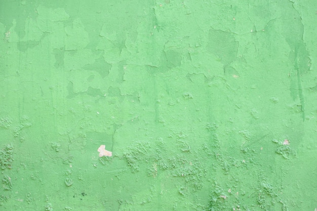 Old green cement wall in industrial building, great for design and texture background.