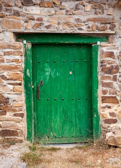Old green door of a spanish house