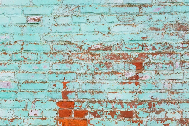 Old green painted brick wall.