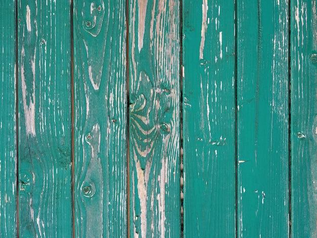 Старая зеленая стена с облупившейся краской