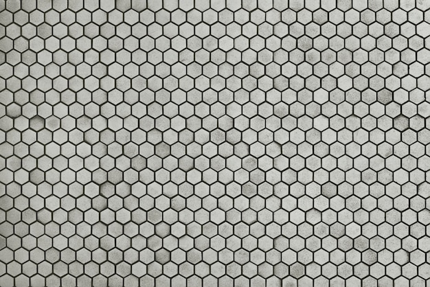 Old grey mosaic wall background texture
