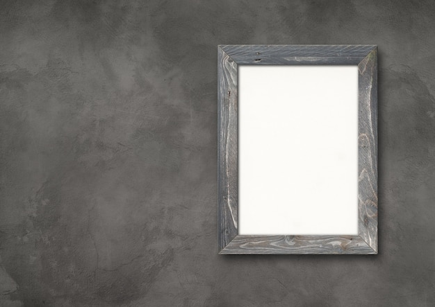 Old grey rustic wooden picture frame hanging on a dark concrete wall. horizontal banner. blank mockup template