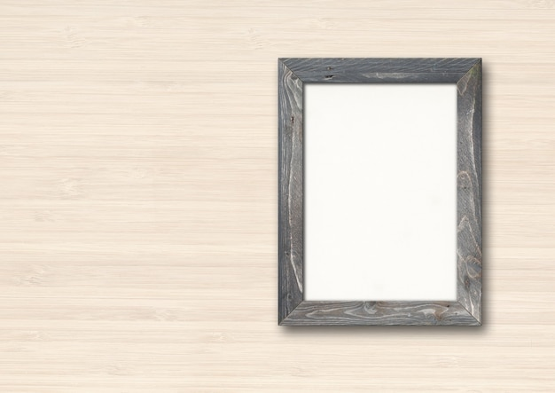 Old grey rustic wooden picture frame hanging on a wood wall. horizontal banner. blank mockup template