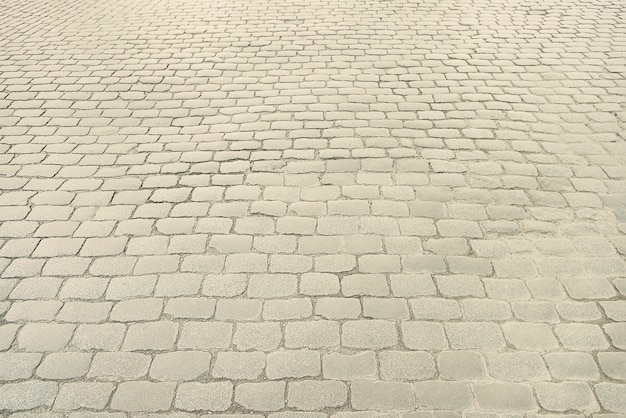 Old grey stone pavement background texture
