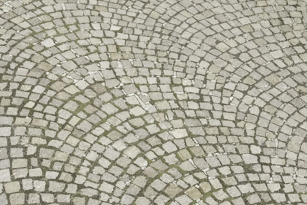 Old grey stone pavement background