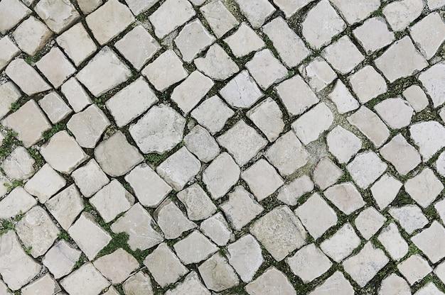 Old grey stone pavement background
