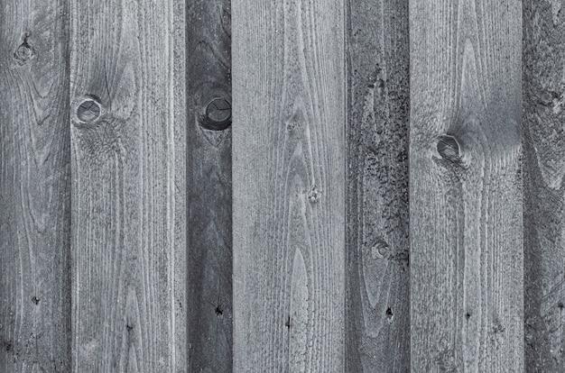 古い灰色の木製の背景。グランジテクスチャ。閉じる。