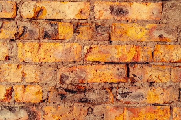 古いグランジ茶色のレンガの壁のテクスチャ背景