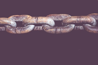 Old grunge chains link isolated on black background