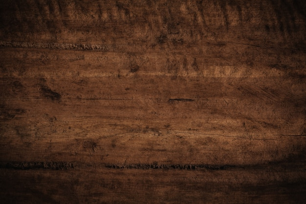 Old grunge dark textured wooden background.