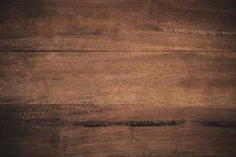 Old grunge dark textured wooden background.