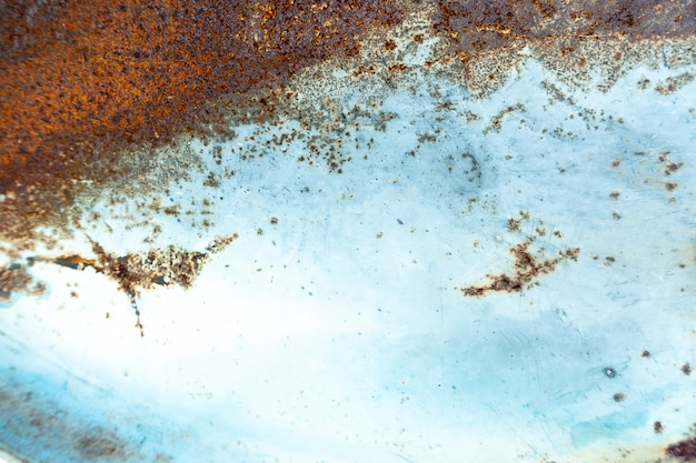 Old grunge vintage background: rusty metal surface with blue paint flaking and cracking texture