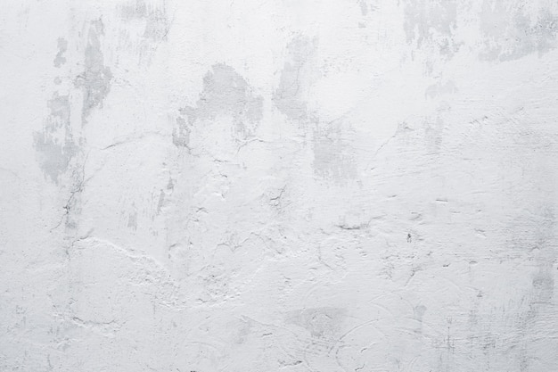Old grunge white wall background. texture of aged whitewashed wall