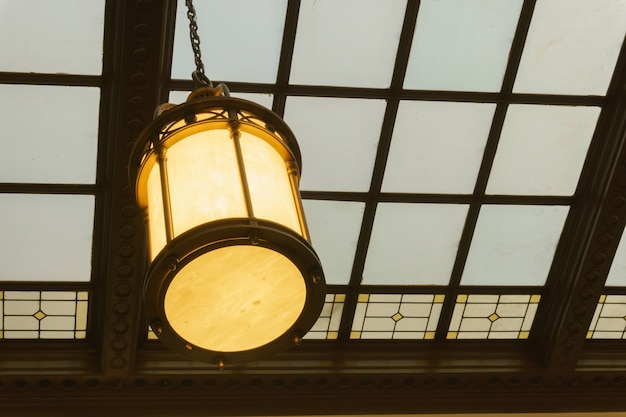 Old hall in building station waiting room glass ceiling hall vintage lamp