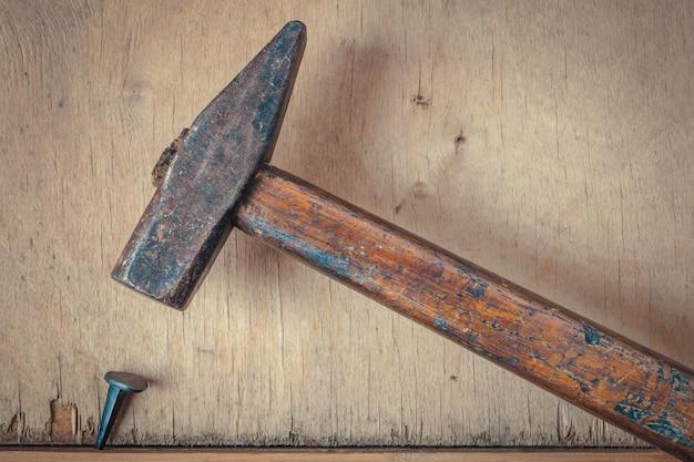 Old hammer and nail