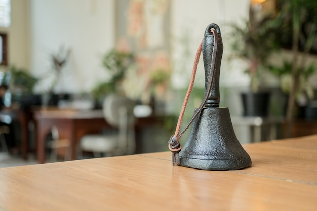 Old hand bell for service bell on a hotel reception desk