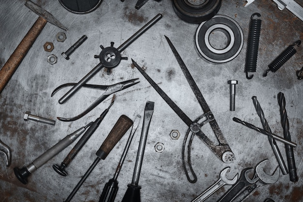 Old hand tools on metal grunge surface
