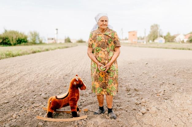 Old happy woman childhood memories of past