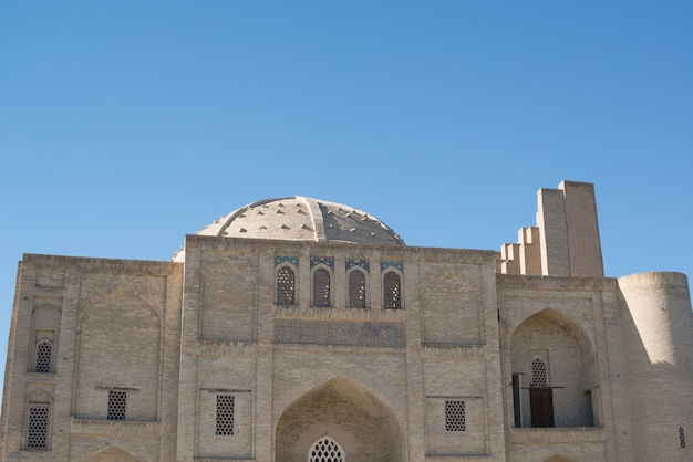 Old historical building with arch and dome. ancient buildings of medieval asia. bukhara, uzbekistan