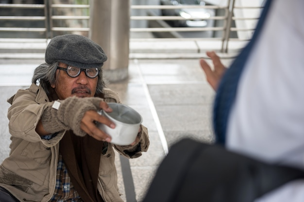 Old homeless man ask for money but refuse
