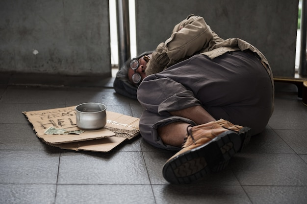 Old homeless man sleep on footpath