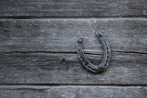 Old horseshoe on an old wooden board