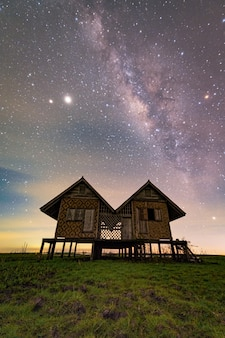 Old house with milkyway in phatthalung