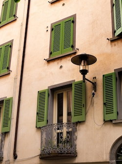 Old house with wooden green shutters and twisted balcony of rovinj, croatia istria. tourist attraction