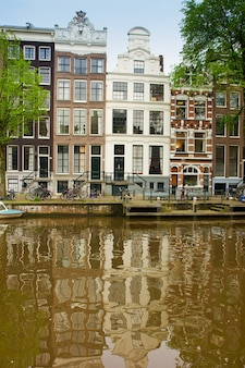 Old houses on canal in amsterdam, netherlands