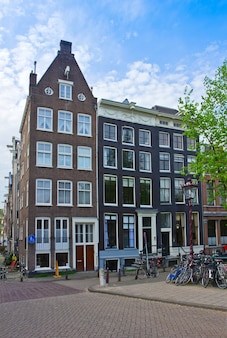 Old houses on canal ring in amsterdam, netherlands