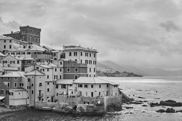Old houses on the coast by the sea in boccadasse in genoa, italy