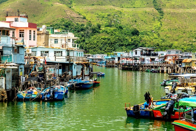 Old houses standing in the water in fishing village tai o, lantau, hong kong, sar of china.
