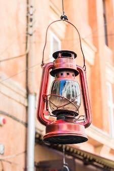 Old hurricane lamp on the street. vintage lamp. kerosene lamp. old-fashioned equipment. ga