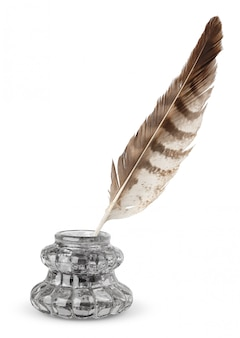 Old inkstand and quill isolated on white