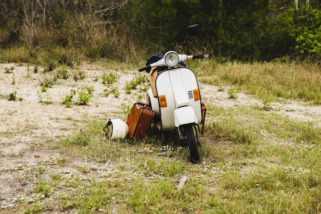 Old italian style motorcycle with two travelers.
