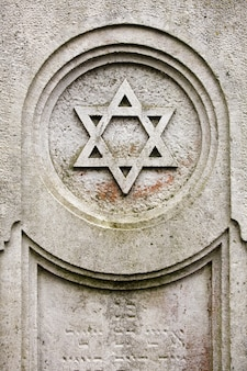 An old jewish cemetery with religious symbols.