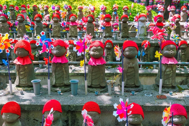 Old jizo statues in temple, tokyo, japan.
