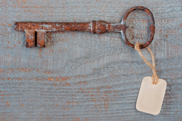 Old key with a paper label
