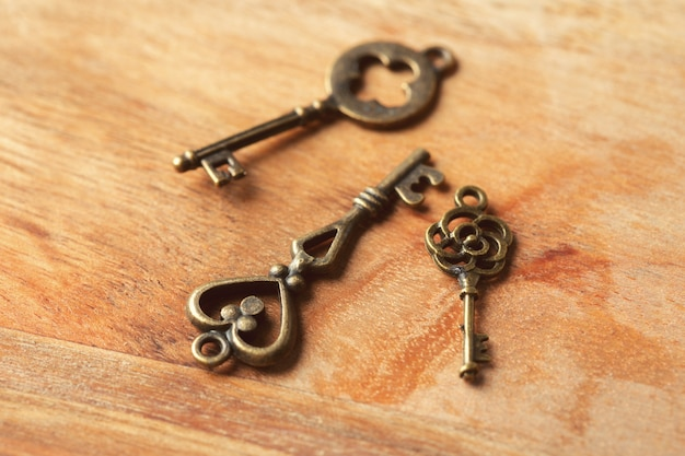Old key on wooden table